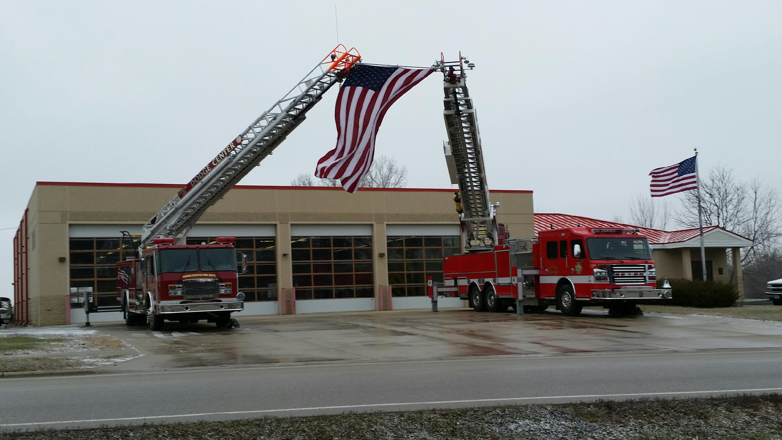 Fire Engines Draping American Flag
