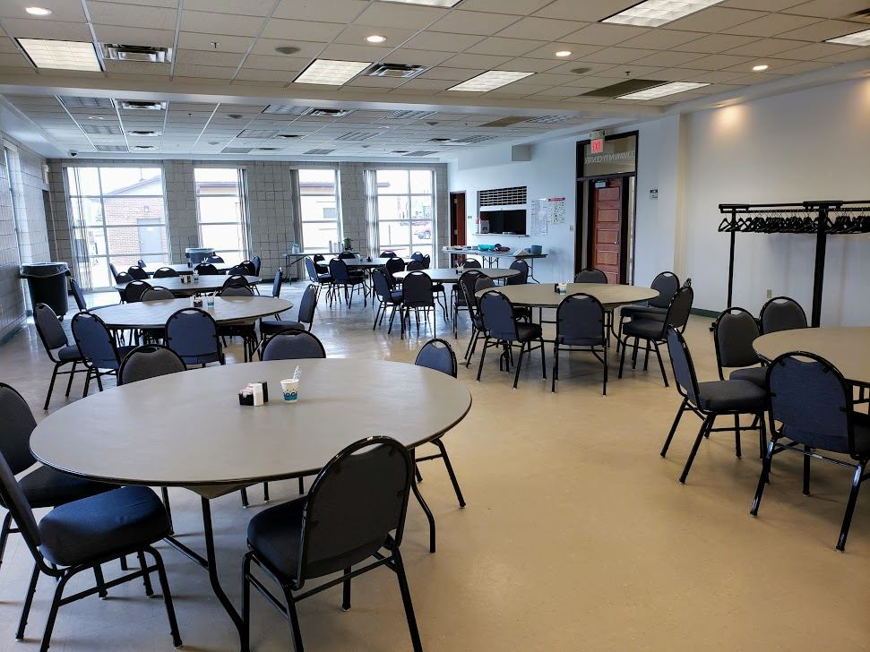 Tables and Chairs set up in the Community Center